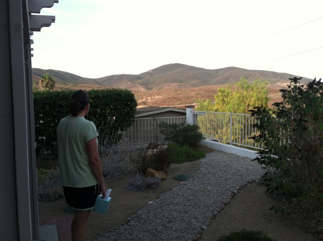 Amelia saying goodbye to the beautiful view from our backyard.