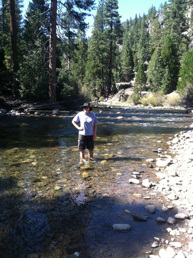Amelia wading in a tame section of the middle fork of the Stanislaus River.
