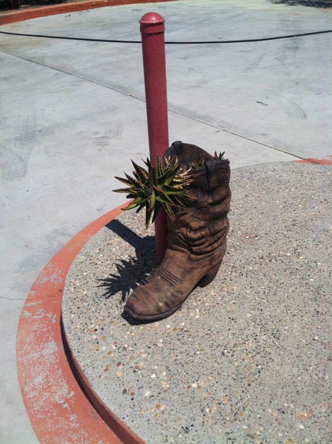 Boot on the sign, boot on the patio. It's the little things!
