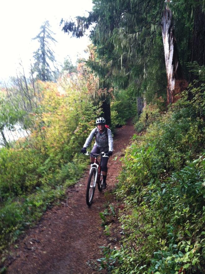 Amelia riding the McKenzie River Trail.