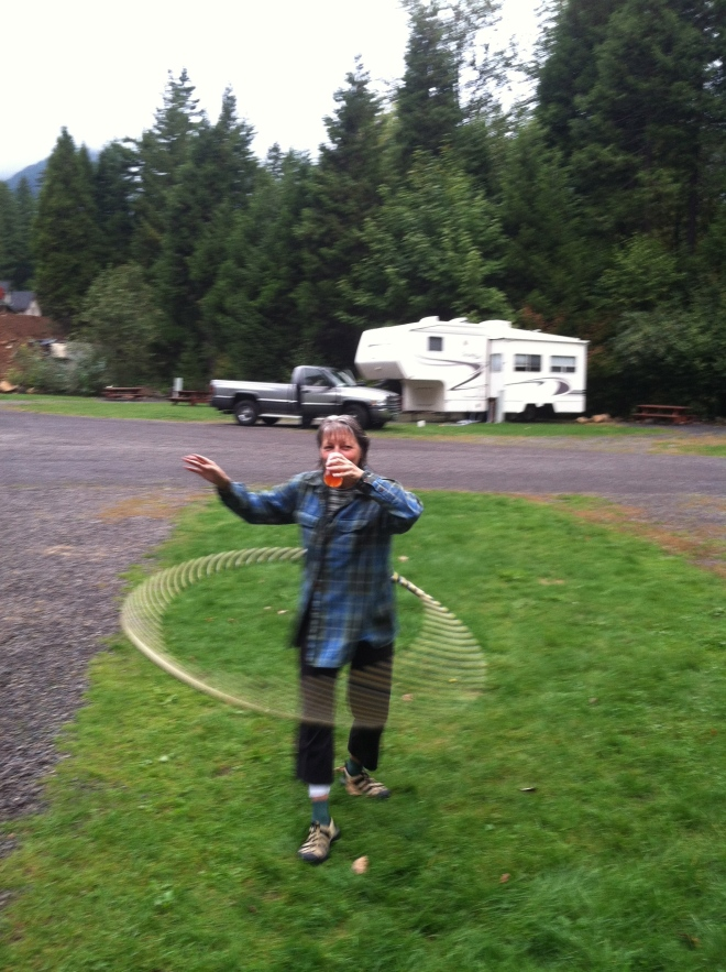Gail, two upping Amelia. Walking and drinking beer while hula hooping.