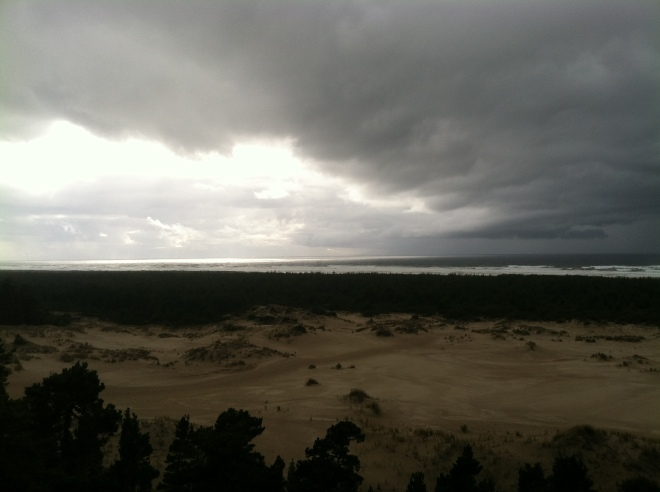 We arrived at the Oregon Dunes National Recreation Area to see what looked like a huge storm approaching. The iPhone said it wouldn't start raining until 6 o'clock. It was only 4:30, so we took off on the hike to the beach.