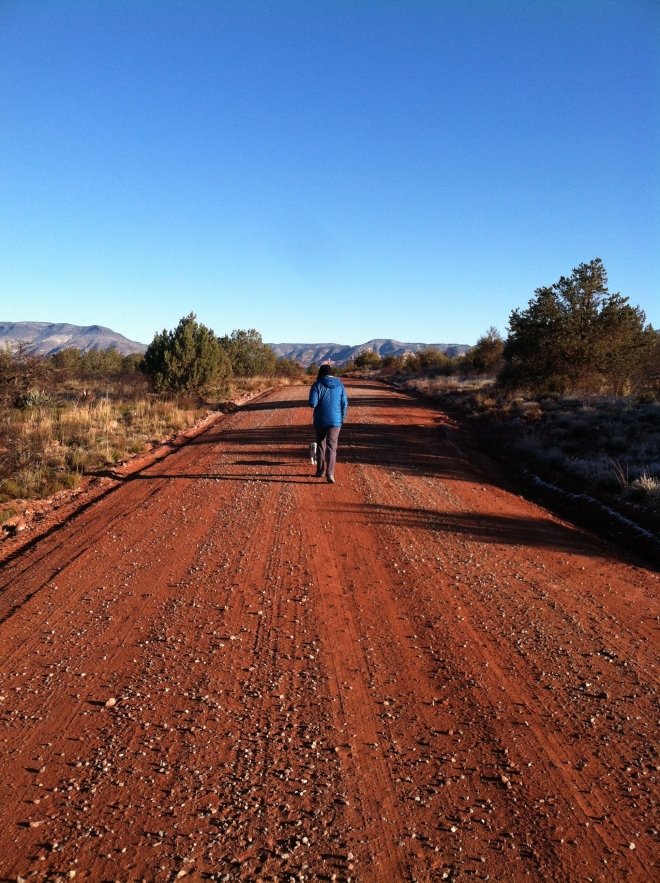 My two girls, out for a morning stroll on a red dirt road.
