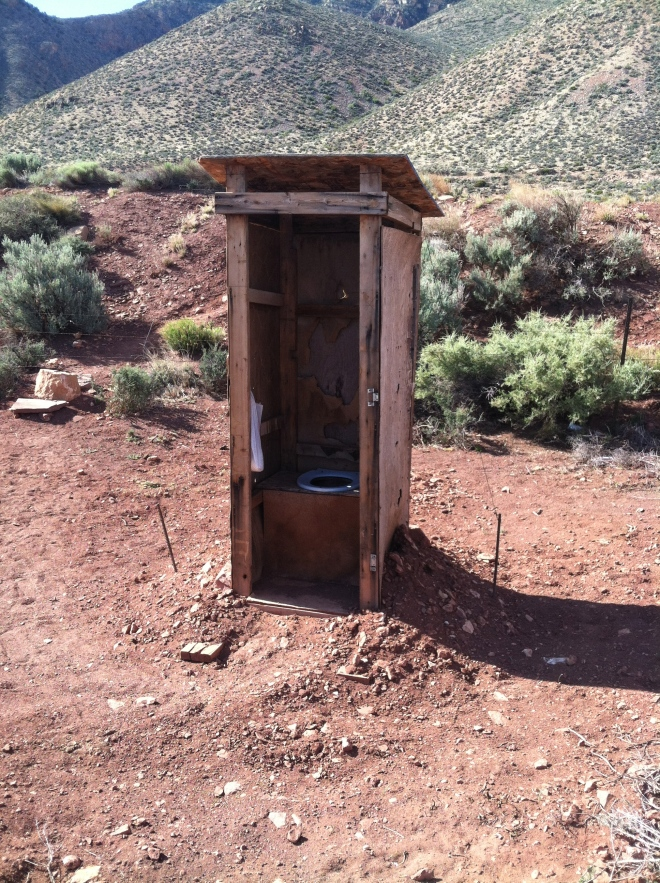 The outhouse the lady uses that runs the roadside stand.