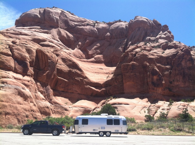 Rest stop south of Moab just past a tourist trap called Hole in the Rock. Air conditioned bathrooms and big shady trees. Plus two chatty guys that run the place.