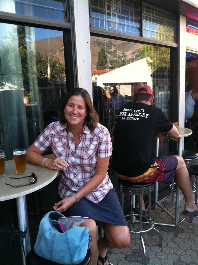 "Lucky lady living the life. Central Coast Brewing. Check out the guy's t-shirt, ""Small craft BEER ADVISORY in effect."" How great is that?"