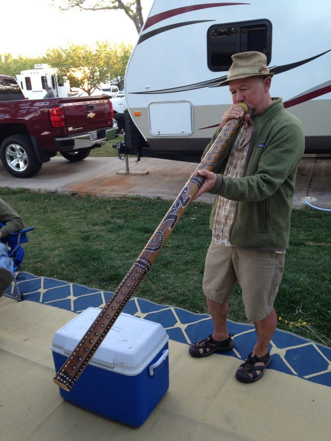 Roger playing a didgeridoo.